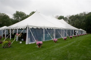 Optional decorative elements such as centre pole draping and chandeliers provide additional upscale elegance to this crowd pleasing tent style. & Pole Tent Rental